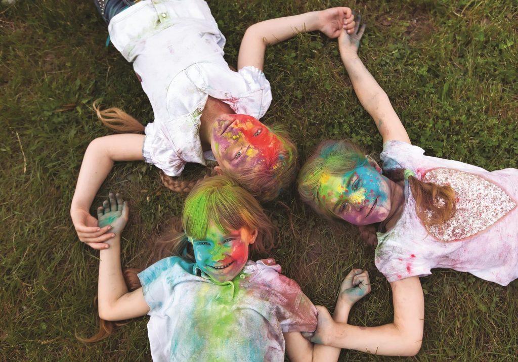 bigstock-Children-Lie-On-The-Grass-Chi-312049267