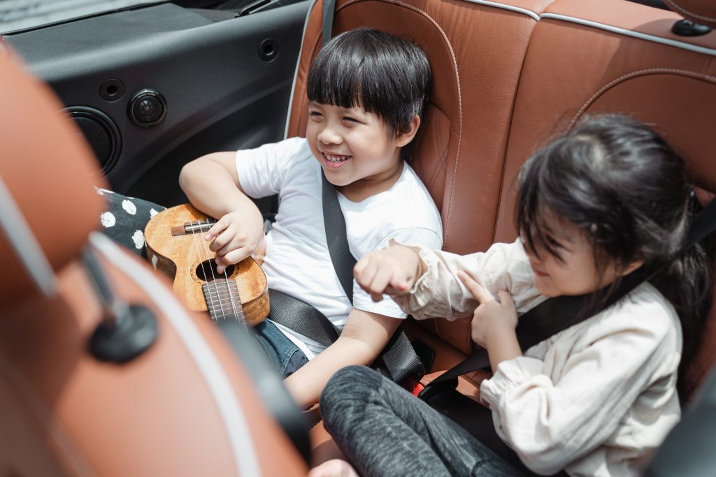 It is important to pack entertainment options to keep your family occupied during longer stretches of driving. Photo by Ketut Subivanto from Pexels